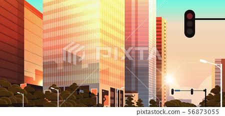 beautifil city street with traffic light skyline high skyscrapers modern cityscape sunset background 56873055