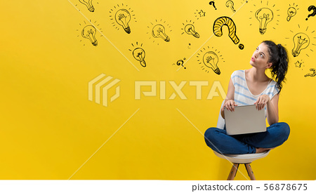 Question with light bulbs with woman using a laptop 56878675