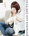 young woman is suffering from a cold 56879335