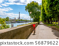 Red Bike on the Sunny Promenade of the Seine 56879622