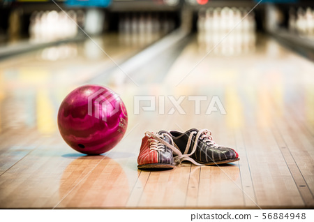 Pair of bowling shoes and ball 56884948