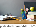 School supplies, stack of books, chalk board and 56886125