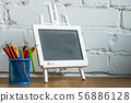 Close-up miniature chalk board and stand with 56886128