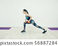 Strong woman working out with dumbbells 56887284