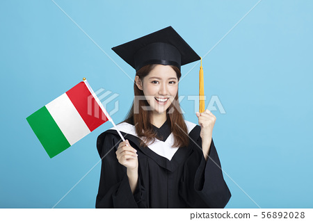 happy Young female graduation student showing the 56892028