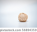 wool ball on light grey background 56894359