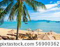 Beautiful tropical beach sea and ocean with coconut palm tree and umbrella and chair on blue sky and white cloud 56900362