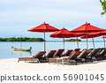 Beautiful outdoor tropical beach sea ocean with umbrella chair and lounge deck around there on white cloud blue sky 56901045