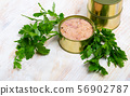 Canned tuna with parsley and lemon on a wooden table 56902787