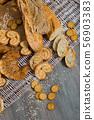 Top view of various bakery goods on rattan mat 56903383