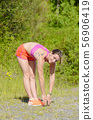 Fitness woman doing exercise 56906419
