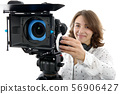 beautiful young woman with DSLR video camera 56906427