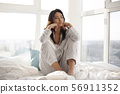 Depressed Woman on Bed at Home 56911352