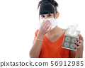 sick young woman blowing her nose on white 56912985