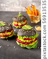 Vegan black burgers with beet patties and avocado on dark background 56913535