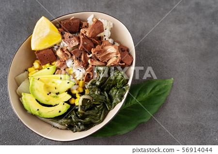 Close up of vegan healthy bowl with rice, salad and jackfruit 56914044