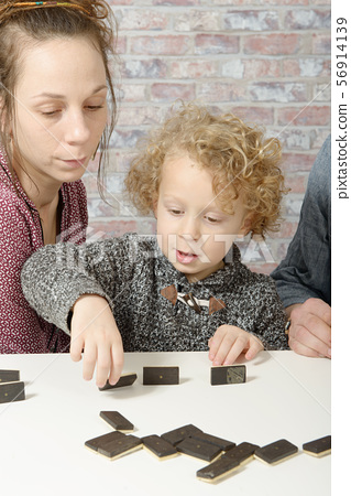 happy family playing dominos 56914139