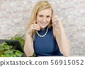 beautiful young businesswoman talking on phone 56915052