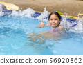 Happy girl relaxing enjoying hot tub bubble bath 56920862