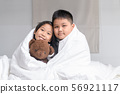 brother hug sister under blanket 56921117