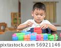 Cute little boy is playing wood brick 56921146