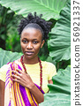 African woman in jungle pressed her hand to chest 56921337