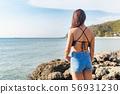 Young asian woman wearing bikini standing facing 56931230