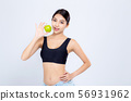 Portrait asian woman holding and eating apple 56931962