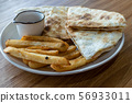 French fries and quesadilla on plate 56933011