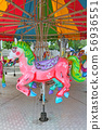 Horses on a carnival Merry Go Round in temple fair 56936551