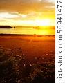 Sandy beach illuminated by the setting sun 56941477