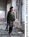 Soldier girl with weapons in camouflage uniform in 56946450