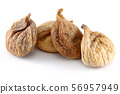 Heap of dried figs isolated on white 56957949