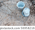 Twin plastic bucket with the cement stain. 56958216
