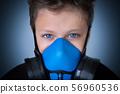 Young boy wearing gasmask, respirator portrait 56960536