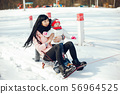 Mother with little daughter 56964525