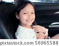 Asian girl sitting and smiling with safety belt in 56965588
