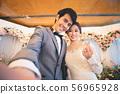 Bride and groom selfie photo at wedding ceremony.. 56965928