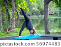 Woman more than 50 year old practicing yoga 56974483
