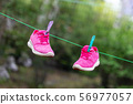 Pair of bright sport fitness sneakers hanged on 56977057