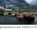 Scenic Harbor With Fishing Boats And Colorful Apartment Houses At John o'Groats In Scotland 56991179