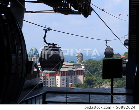 Singapore Harbor Front Cable Car and Sentosa Merlion 56992624