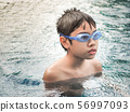 Cute boy in the swimming pool. Happy asian boy in the pool. 56997093