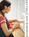 Woman sewing silk scarf 57001104