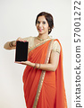 Proud woman showing tablet 57001272