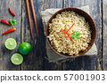 Instant noodles in  wooden bowl on wood background 57001903