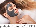 Facial Skin Care. Beautiful Woman Getting Cosmetic Mask In Salon 57001914