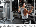 Man exercising in pull down machine 57002616