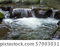 A mountain stream in the Okuju Valley that flows through stone steps 57003031