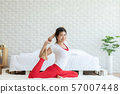 Attractive Asian woman practice yoga yoga mermaid pose to meditation in bedroom after wake up in the morning Feeling so comfortable and relax,Healthcare Concept 57007448